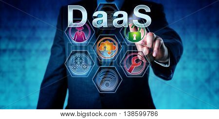 Male software developer is pushing DaaS on an interactive touch screen. Business concept. Information technology metaphor for Desktop as a Service user virtualization and disaster recovery strategy.