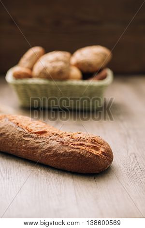 Fresh crisp bread on the kitchen table healthy food and bakery concept