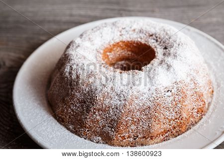 Home Made Freshly Baked Whole Marble Cake Covered With Powdered Sugar
