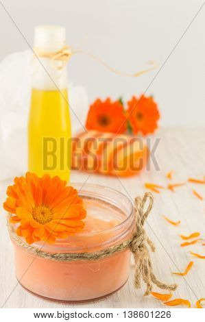 Marigold Cosmetics Products With Fresh Flower Bouquet