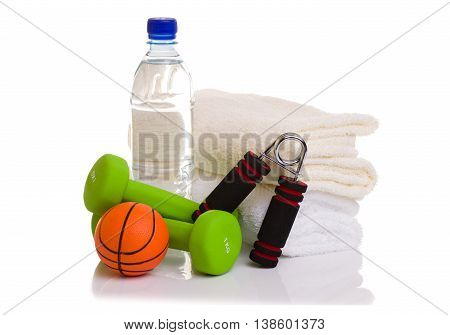 fitness equipment isolated on white. towel, two green dumbbells, simulator for hand, ball and bottle of water.