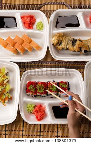 assorted fresh sushi and rolls, top view