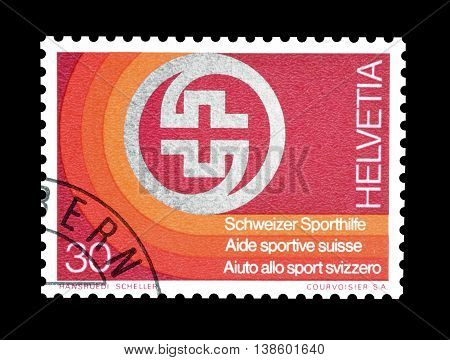 SWITZERLAND - CIRCA 1974 : Cancelled postage stamp printed by Switzerland, that shows Badge of Swiss Sport Aid.