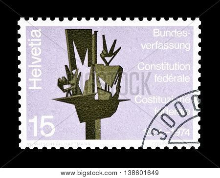 SWITZERLAND - CIRCA 1974 : Cancelled postage stamp printed by Switzerland, that shows sculpture by Werner Witschis.
