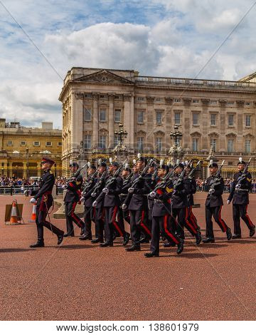 LONDON UK - 28TH JUNE 2016: Soldiers at the Changing of the Guard Performance at Buckingham Palace in the summer