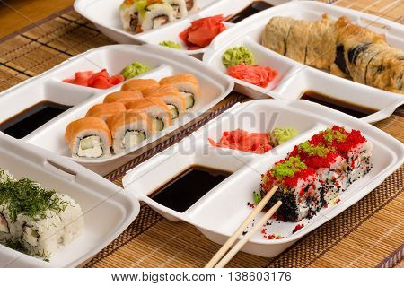 variety fresh sushi rolls on a table
