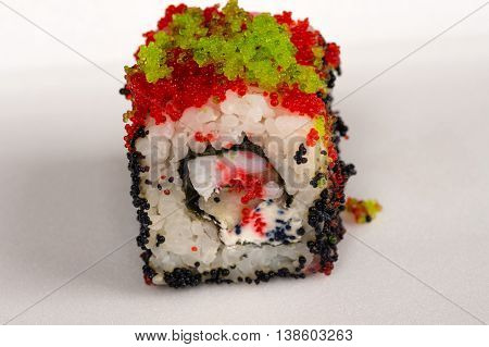 fresh delicious red sushi roll close up