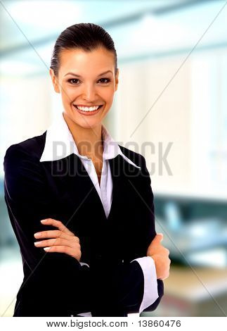 Positive business woman smiling over white background