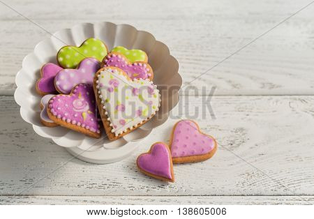 Heart cookies in vase on wooden background