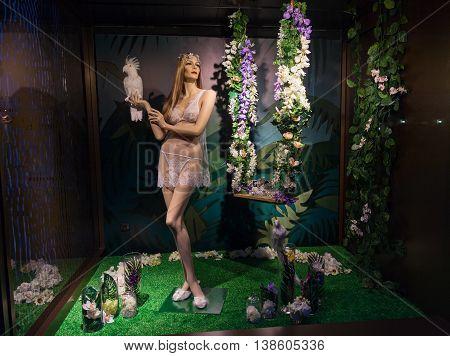 Female mannequin in underwear at night showcase