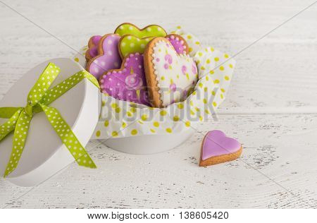 Heart cookies in gift box on wooden background