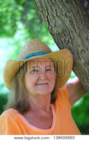 Mature female blond beauty expressions outside in nature.