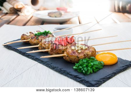 Tsukune - Japanese grilled chicken meatballs on a plate