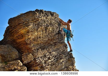 Male Climber In Mountains