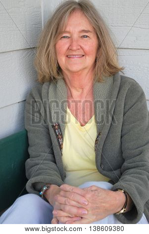 Mature female senior blond beauty expressions outside