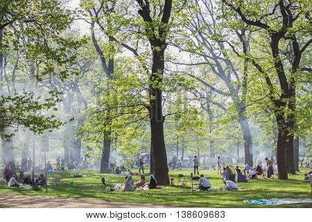 Berlin Germany - April 28 2012: Crowded park with people doing barbecue in berlin Kreuzberg.