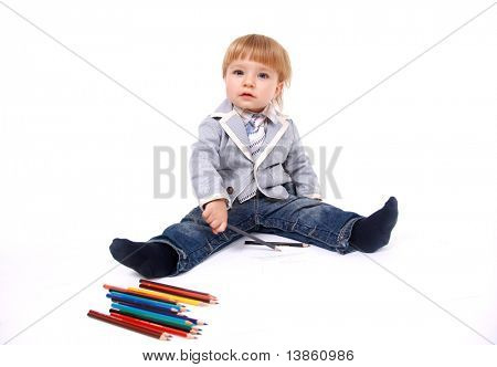 emotional boy with color crayon on white background