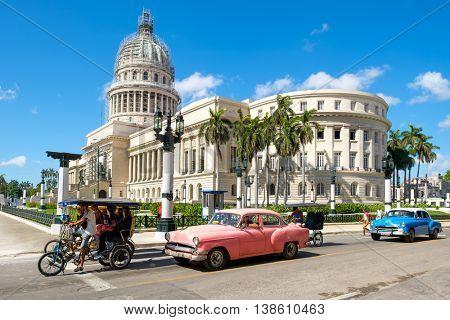 HAVANA,CUBA - JULY 14,2016 : Street scene with classic cars near the Capitol in downtown Havana