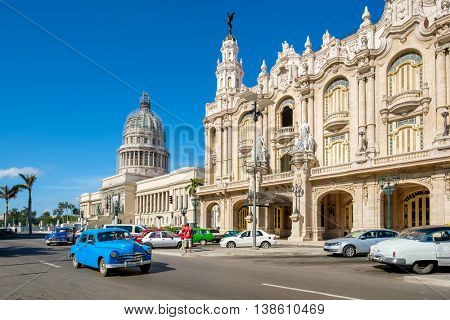 HAVANA,CUBA - JULY 14,2016 :  Street scene with old cars next to the Great Theater of Havana and the Capitol