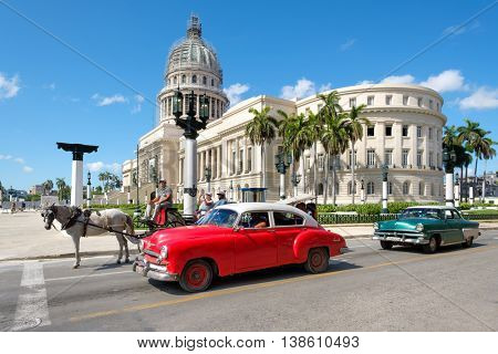 HAVANA,CUBA - JULY 14,2016 : Old classic cars next to the Capitol in downtown Havana