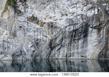 Marble rock water canyon. The marble deposits. Landscape rocks with reflection. Beautiful and majestic nature of the stones.
