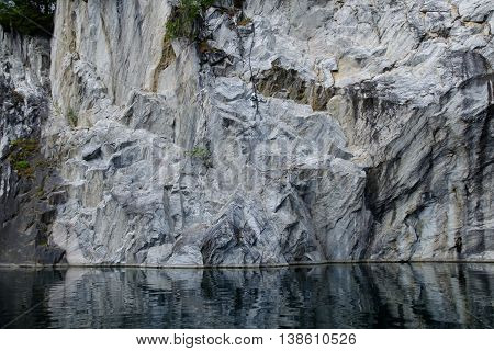 Marble rock canyon. The marble deposits. Landscape rocks with reflection in water. Beautiful and majestic nature of the stones.