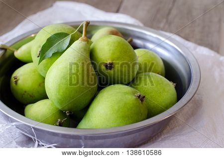 Healthy organic green pears. Close up photo.