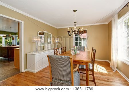 Design Interior. Bright Dining Room With Wooden Table Set.