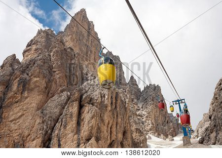 Nice colorful cable car in the Dolomites Italy. (Monte Cristallo massif near to Cortina)