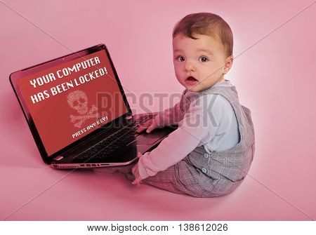 Adorable baby with laptop infected by a ransomware virus which says the computer has been locked.