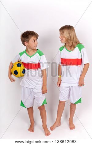 Siblings conflict concept - Sister arguing with her brother holding a soccer ball