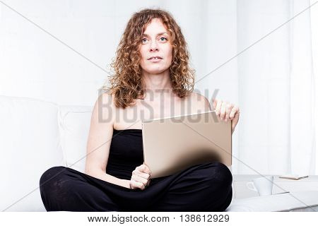 Single Calm Beautiful Woman Holding Large Tablet