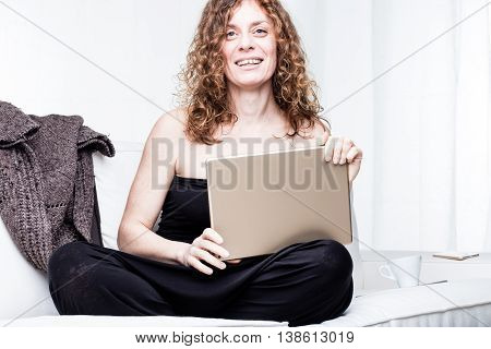 Happy Pretty Woman With Computer And Sweater