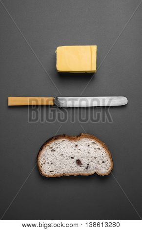 Bread and butter - knife butter and bread viewed from above