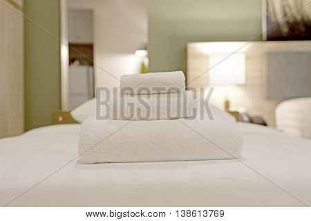White Towels On Bed