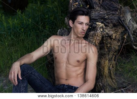 Young Man Sitting Sand Posing Skinny Slim Fit Abs Closeup