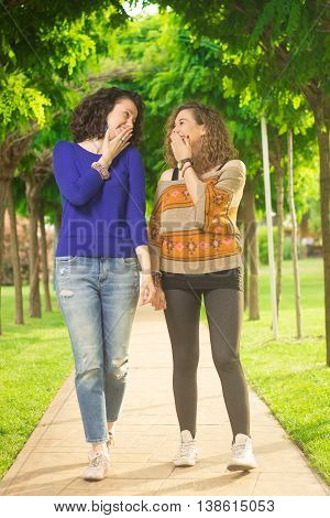 Two Cute Young Adult Women Giggling
