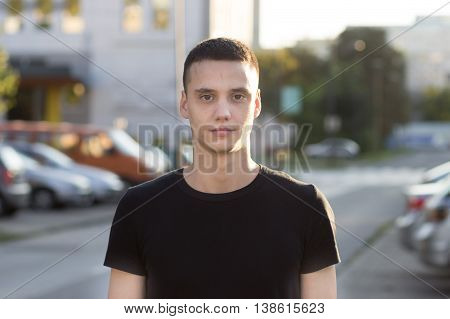 Young Man In 20S Serious Expression Portrait