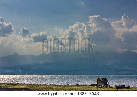 Clouds and mountains over a barren landscape in Indonesia