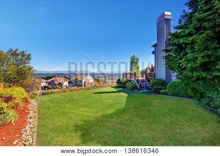 Spacious Back Yard With Grass Filled Garden And Amazing View.