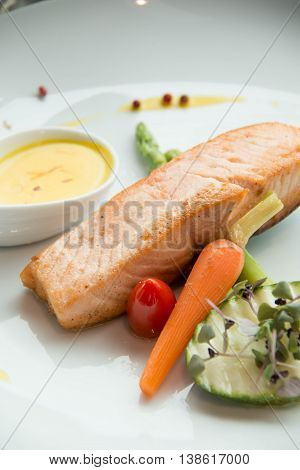 grilled salmon steak with cherry tomatoes and vegetable
