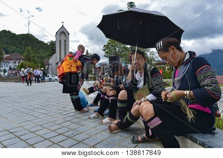 SAPA, VIETNAM, February 11, 2016 Hmong women's group, highland Sapa, Vietnam, sitting embroidered brocade town center, Sapa, Vietnam