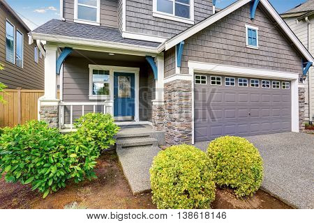 Nice Curb Appeal Of Two Level House, Mocha Exterior Paint And Concrete Driveway