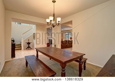 Open Floor Plan. View Of Dining Room With Carved Wooden Table And Living Room