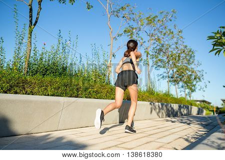 Back view of woman running at outdoor