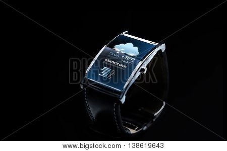 modern technology, weather cast, object and media concept - close up of black smart watch with meteo forecast on screen