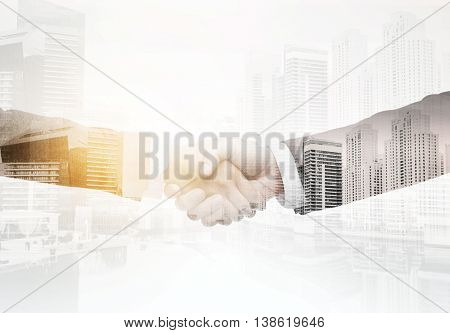 business, people, partnership, gesture and cooperation concept - businessman and businesswoman shaking hands over city with double exposure effect background
