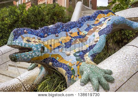 BARCELONA SPAIN - JULY 3 2016: Lizard of Gaudi mosaic in park Guell in Barcelona. Park Guell (1914) is the famous architectural town art designed by Antoni Gaudi.