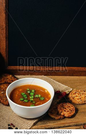 Goulash soup and wooden blackboard on a table