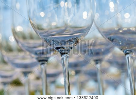 Blurred And Bokeh Of Wine And Champagne Glass Setting For Wedding Ceremony.